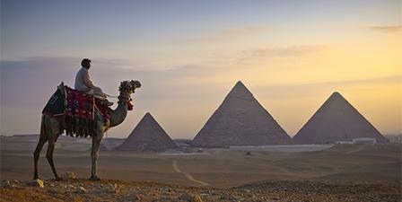Camel riders at Giza Pyramids, Giza, Cairo, Egypt