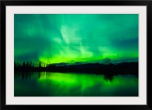 Green Aurora Borealis over small pond in Kluane National Park, Yukon Territory, Canada