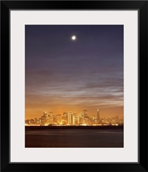 Moon setting over San Francisco on hazy December evening, taken from Treasure Island.