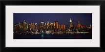 Skyscrapers lit up at night in a city, Manhattan, New York City, New York State