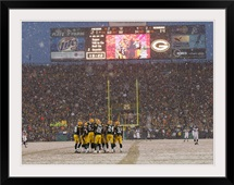 Green Bay Packers Huddle at Lambeau Field