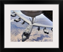 A B52 Stratofortress receives fuel from a KC135 Stratotanker over Afghanistan