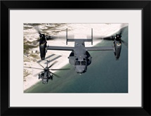 A CV22 Osprey and an MH53 Pave Low fly over the coastline of Florida