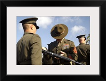A senior drill instructor inspects a recruits rifle for cleanliness