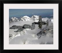 A10 Thunderbolt IIs fly over mountainous landscape