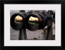 Aircraft carrier USS Dwight D Eisenhower is reflected in a set of Big Eyes binoculars