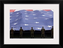 Airmen present the American Flag during the National Anthem