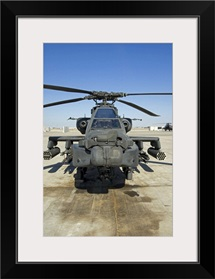 An AH64D Apache Longbow Block III attack helicopter sits on the flight line