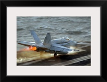 An F/A18C Hornet launches from the flight deck of USS Theodore Roosevelt