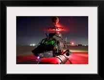 OH58D Kiowa pilots run through their preflight checks before taking off