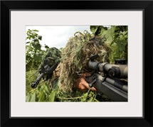 Soldiers dressed in ghillie suits
