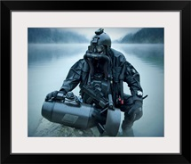 Special operations forces combat diver with underwater propulsion vehicle