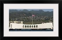The Ensign flies over the Arizona Memorial