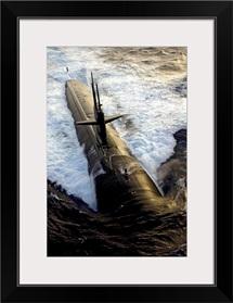The Los Angelesclass submarine USS Albuquerque surfaces in the Atlantic Ocean