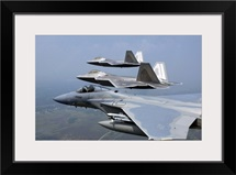 Three F/A22 Raptors fly in formation during a training sortie