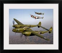 Three Lockheed P 38 Lightnings in flight