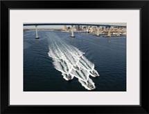 US Navy patrol boats conduct operations near the Coronado Bay Bridge in San Diego