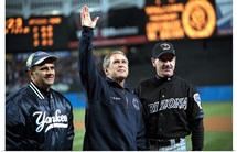 President George W. Bush waves to the World Series crowd at Yankee Stadium
