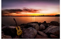 Sunrise at beach with guitar.
