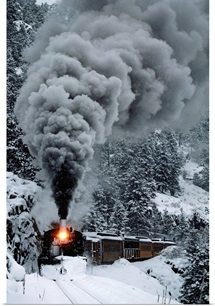The Durango & Silverton Narrow Gauge Railroad train chugs through the snow, San Juan Mountains, Colorado