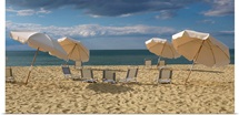 Deck chairs and beach umbrellas on the beach, Jetties Beach, Nantucket, Massachusetts