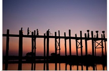 People walking on Ubein Bridge at Sunset, Mandalay, Burma