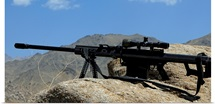 A Barrett .50-caliber M107 Sniper Rifle sits atop an observation point in Afghanistan