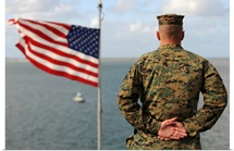 A soldier stands at attention on USS Bonhomme Richard