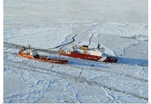 USCG Healy breaks ice around a Russian-flagged tanker south of Nome, Alaska