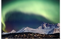 Aurora Borealis over hillside neighborhood &amp;amp; Chugach Mountains Anchorage Alaska