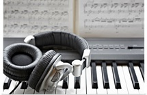 Headphones on electronic piano keyboard