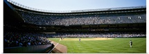 Spectators watching a baseball match in a stadium, Yankee Stadium, New York City, New York State