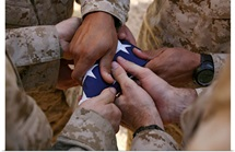 Marines fold an American flag