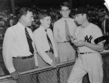 Joe Di Maggio autographs baseball for Gov, Thomas Dewey's sons, Tommy and Johnny, 1948