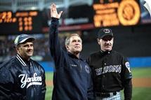 President George W. Bush waves to the World Series crowd at Yankee Stadium