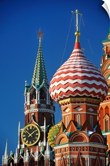 Spasskaya Tower of Kremlin and St. Basil Cathedral in Moscow.