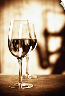 Two Glasses of White Wine with Musician Shadow in Background