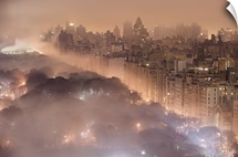 Light pollution and fog combine to blur a New York City skyline