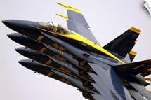 Four Blue Angels F/A18C Hornets perform the Echelon Parade maneuver