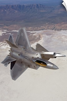 Two F-22 Raptors maneuver while on a training mission over New Mexico