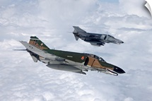 Two QF-4Es fly over the Gulf of Mexico