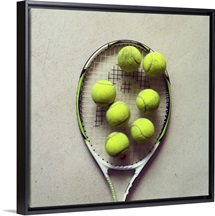 Tennis racquet and tennis balls.