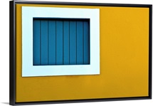 Window on yellow wall.