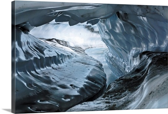 A water channel cuts a tunnel through the ice of the Matanuska Glacier