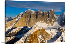 Aerial view of Mooses Tooth and Broken Tooth mountains in winter Denail National Park