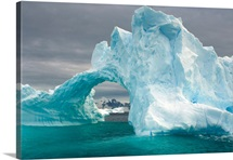 Arched iceberg floating off the Western Antarctic Peninsula