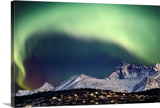 Aurora Borealis over hillside neighborhood &amp; Chugach Mountains Anchorage Alaska