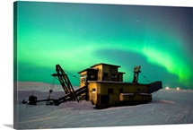 Green Northern Lights Dance Over A Historical Gold Dredge Near Nome, Alaska