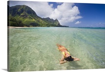 Hawaii, Kauai, Tunnels Beach, Woman Floating In The Ocean