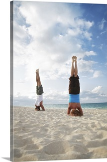 Hawaii, Oahu, Lanikai, Young Couple Doing Yoga On The Beach